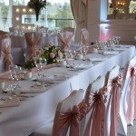 white chair covers with love events signage